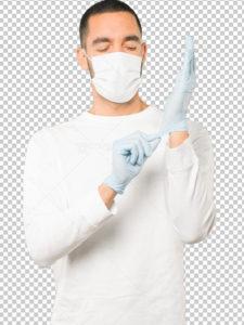 عکس دوربری مرد با ماسک پزشکی تنفسی در حال پوشیدن دستکش PSD